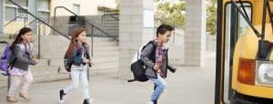 Elementary school kids leaving school to get the school bus