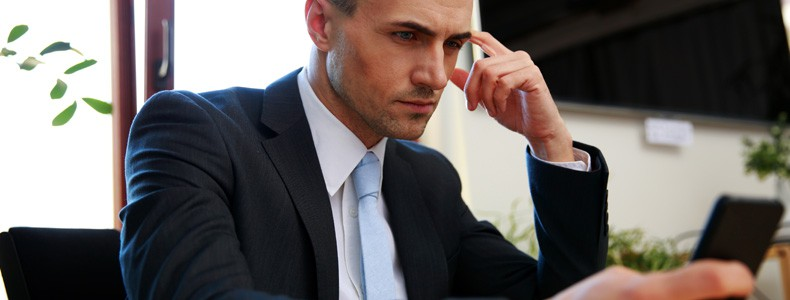 Lawyer sitting on his workplace and using smartphone in office