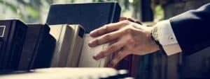 Closeup of hand getting a book