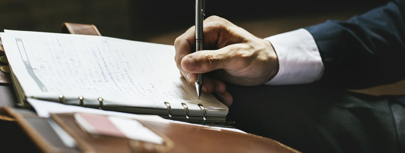 Lawyer writing a note