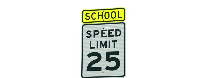 School and 25 mph sign