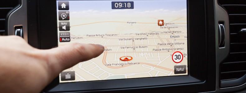 Navigation panel inside a car. Finger pointing on destination