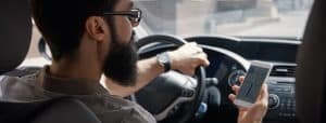 Man using mobile phone while driving